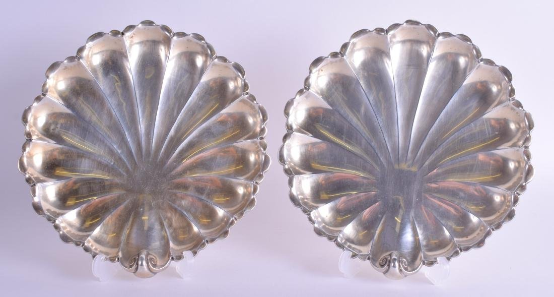 A PAIR OF ANTIQUE CONTINENTAL WHITE METAL SHELL SHAPED