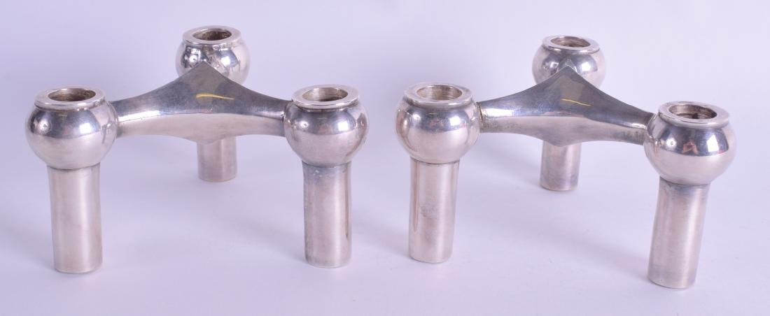 A PAIR OF 1950S CONTINENTAL WHITE METAL CANDLESTICKS.