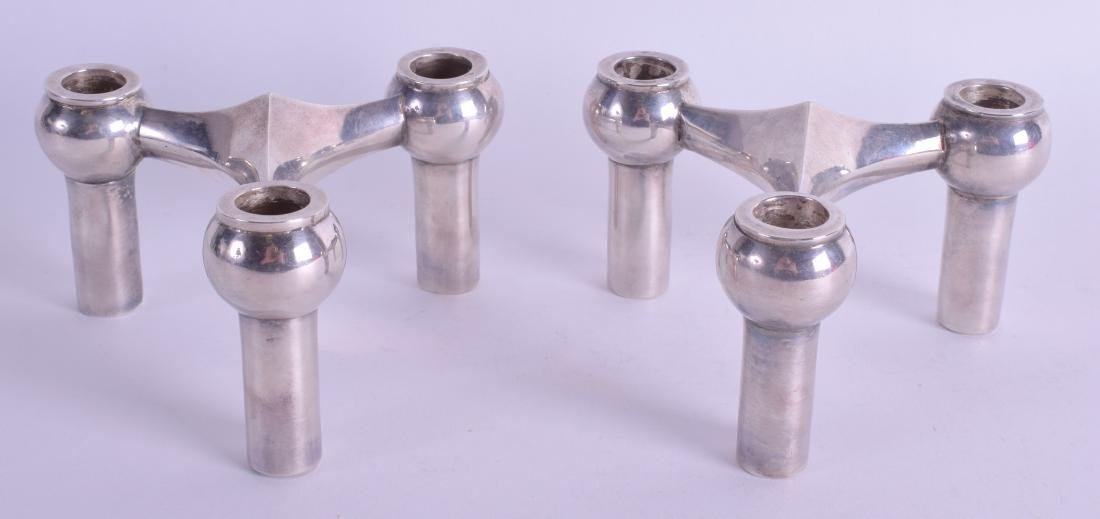 A PAIR OF 1950S CONTINENTAL WHITE METAL CANDLESTICKS. - 2