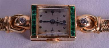 A 14CT GOLD EMERALD AND DIAMOND WRISTWATCH. 24.4 grams
