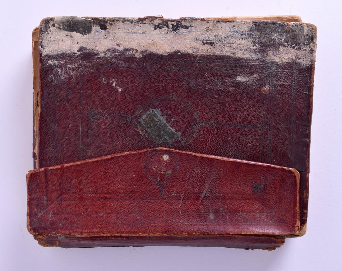 AN EARLY ISLAMIC KORAN with leather binding. - 2
