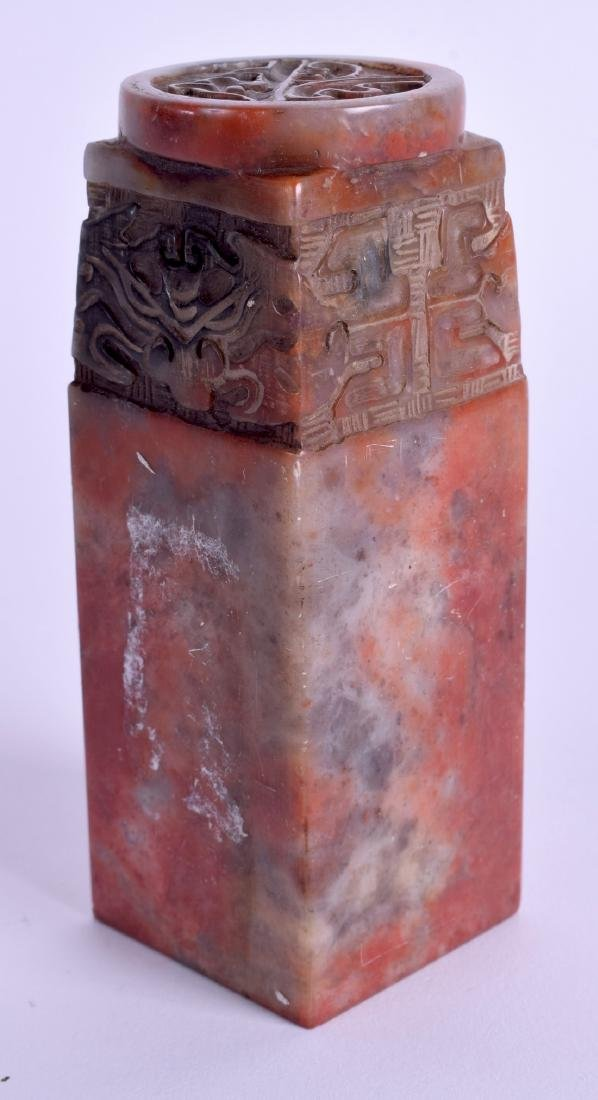 A CHINESE CARVED SOAPSTONE SEAL. 11 cm high.