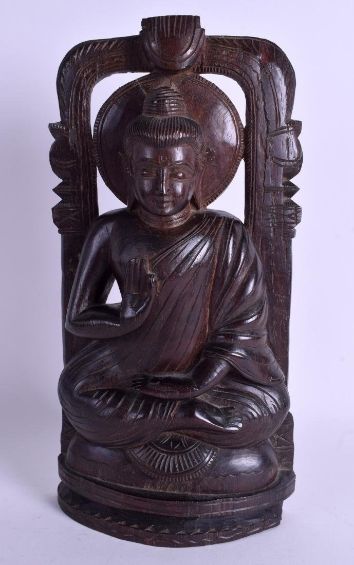 AN EARLY 20TH CENTURY INDIAN CARVED WOOD FIGURE OF A