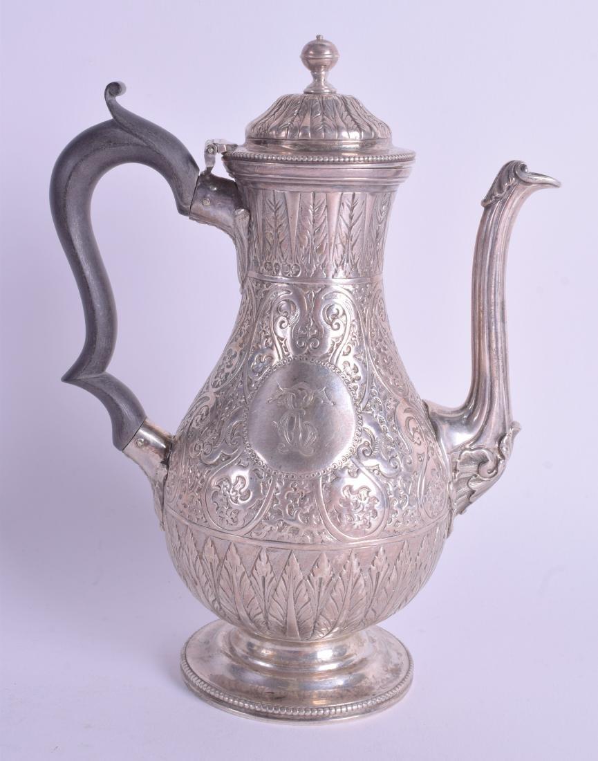 A VICTORIAN SILVER COFFEE POT. London 1879. 15 oz. 21