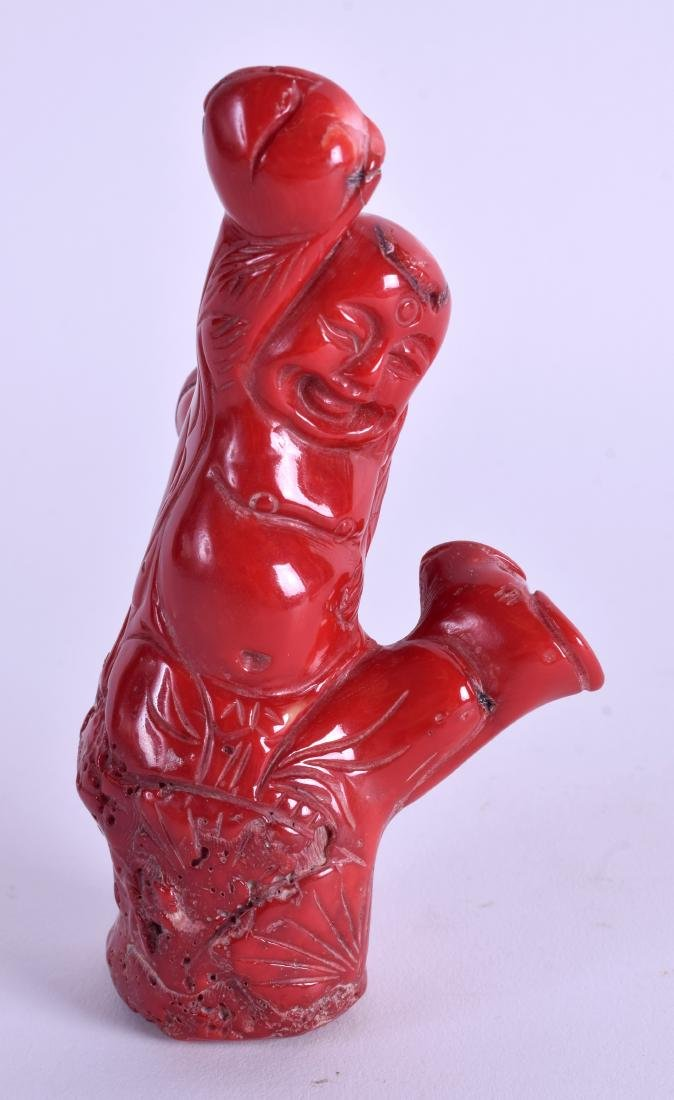 A CHINESE CARVED CORAL BUDDHA. 11 cm  6 cm.