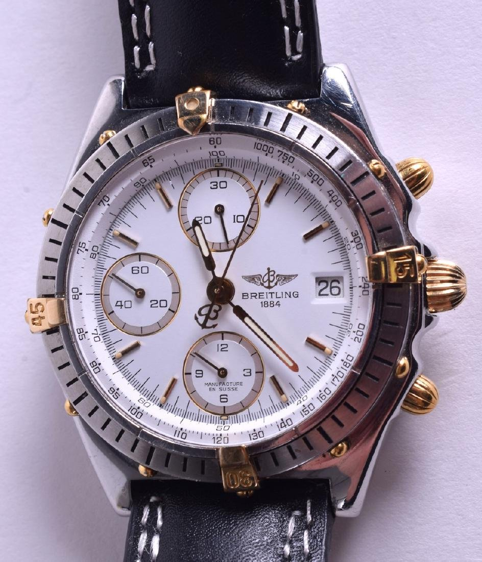 A BREITLING STAINLESS STEEL AND GOLD WRISTWATCH. 3.5 cm