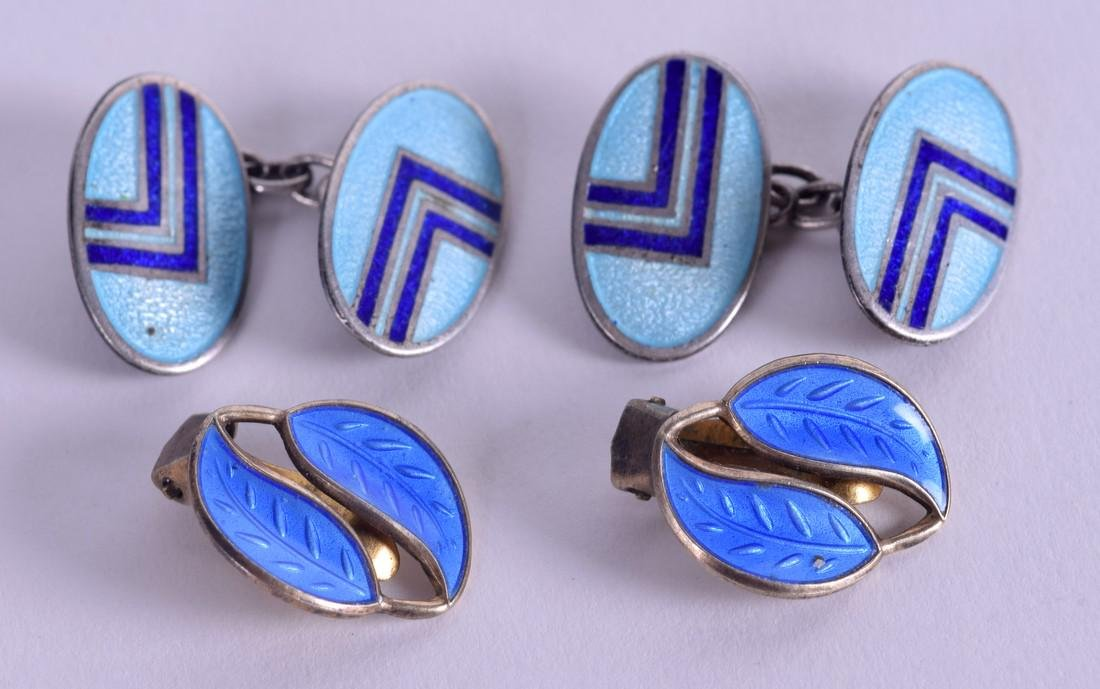 A PAIR OF SILVER AND ENAMEL CUFFLINKS and a pair of