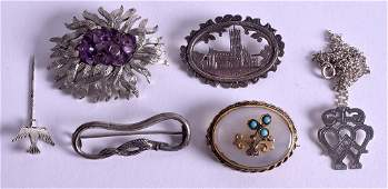 FIVE VINTAGE SILVER BROOCHES together with an early
