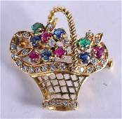 A 14CT GOLD SAPPHIRE DIAMOND RUBY AND EMERALD BROOCH.