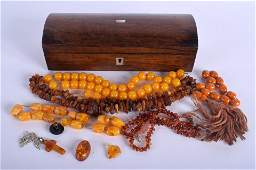 A VICTORIAN BOX together with amber necklaces. (qty)
