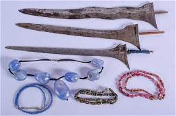 FOUR CENTRAL ASIAN NECKLACES together with three dagger