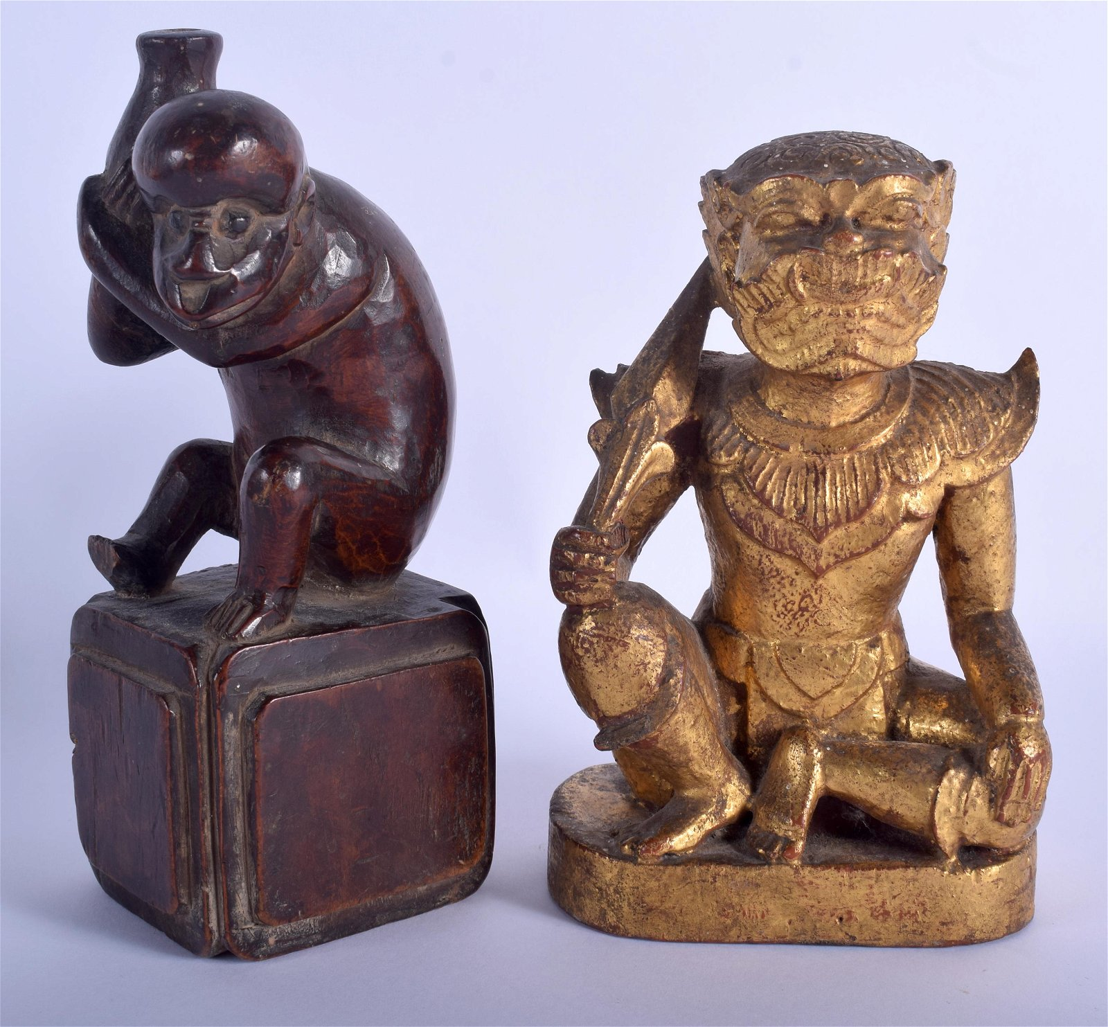 A 19TH CENTURY THAI CARVED GILTWOOD FIGURE OF A