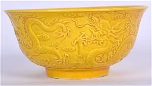 A CHINESE YELLOW GLAZED PORCELAIN BOWL BEARING QIANLONG
