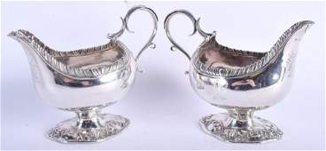 A PAIR OF ARMORIAL GEORGE III SILVER SAUCE BOATS