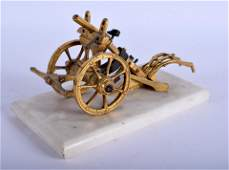A 19TH CENTURY FRENCH INDUSTRIAL GILT BRONZE CANNON