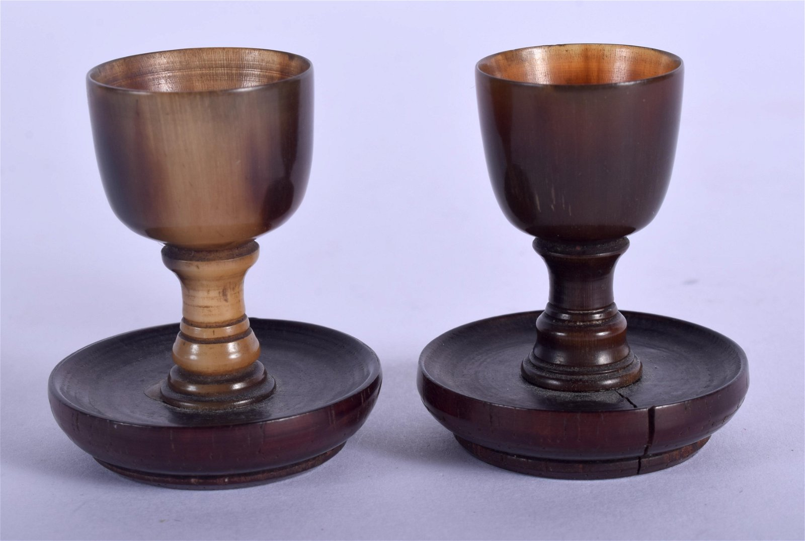 A PAIR OF 18TH CENTURY GERMAN CARVED buffaloHORN CUPS