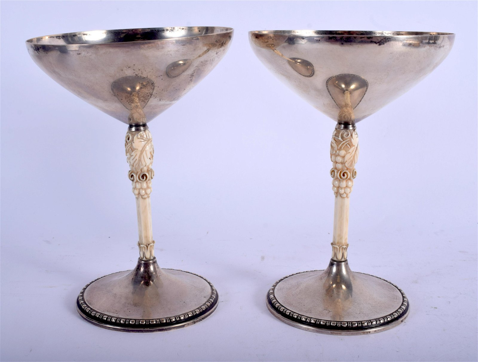 A PAIR ART DECO GERMAN SILVER AND bone TAZZA M T