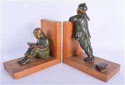 A LOVELY PAIR OF FRENCH PATINATED BRONZE BOOK ENDS