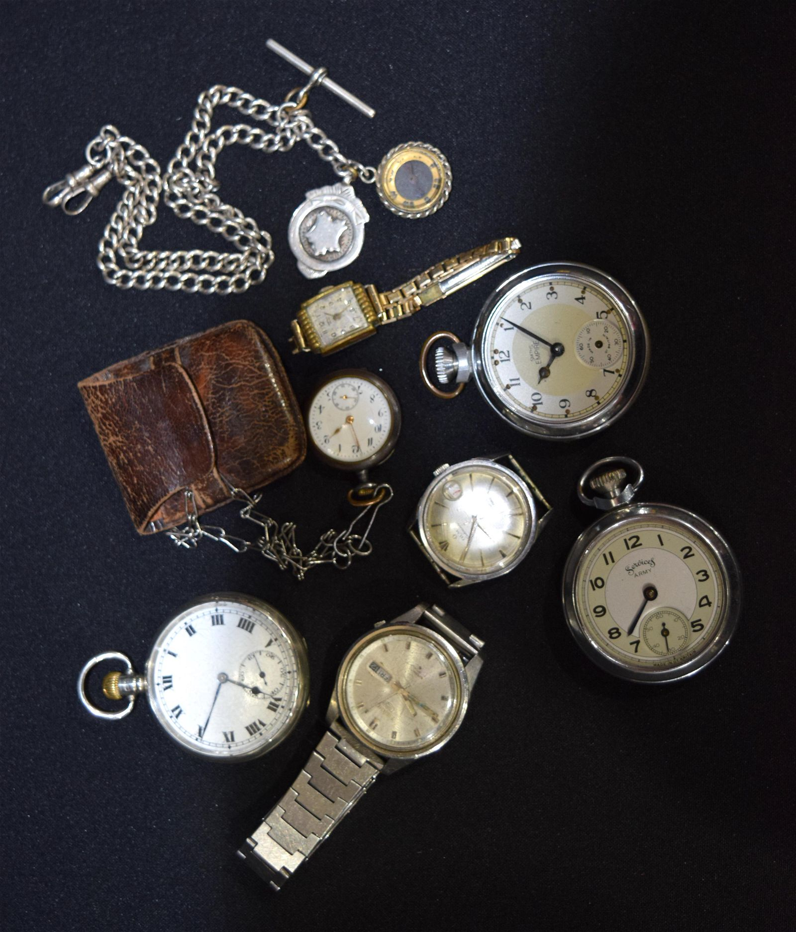 A collection of pocket watches , watches and a silver