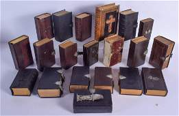 A COLLECTION OF FOURTEEN ANTIQUE SILVER MOUNTED BIBLES