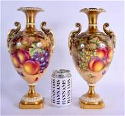 A FINE PAIR OF ROYAL WORCESTER TWIN HANDLED PORCELAIN