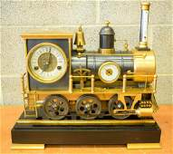 A CONTEMPORARY INDUSTRIAL BRONZE LOCOMOTIVE TRAIN CLOCK