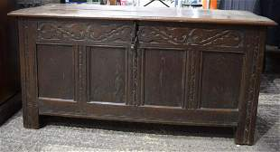 AN 18TH CENTURY OAK BLANKET COFFER CHEST decorated with