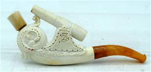 A RARE ANTIQUE MEERSCHAUM AND AMBER  BOAT CANNON PIPE.
