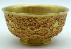 A Chinese gilded metal bowl decorated in relief with