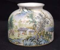 A small Chinese porcelain brush pot, decorated with a