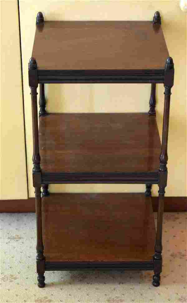 AN ANTIQUE MAHOGANY THREE TIER WHAT NOT of small