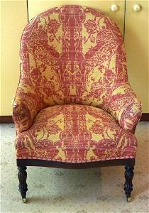 A VICTORIAN UPHOLSTERED ARM CHAIR with rectangular