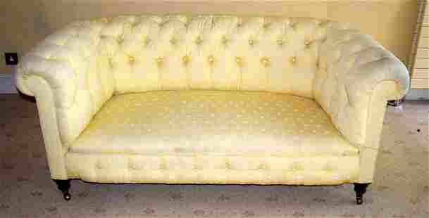 A GOOD QUALITY YELLOW GROUND UPHOLSTERED THEE SEATER