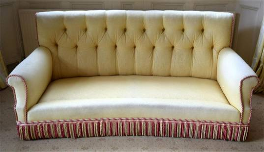 A GOOD QUALITY YELLOW GROUND UPHOLSTERED THREE SEATER