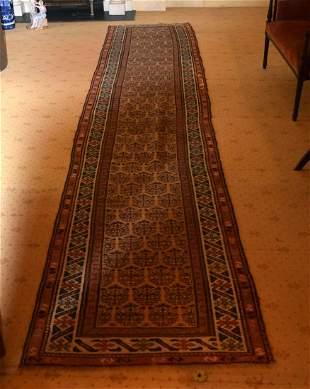 A LONG ANTIQUE PERSIAN RUNNER. 456 cm x 90 cm.