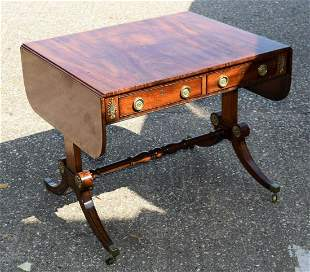 A REGENCY MAHOGANY DROP FLAP SOFA TABLE overlaid with