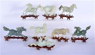 A SET OF EIGHT EARLY 20TH CENTURY CHINESE CARVED JADE