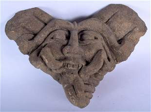 AN EARLY CARVED STONE AZTEC STYLE MASK HEAD. 26 cm x 16