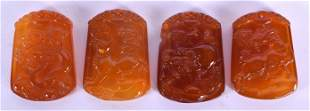 A RARE SET OF FOUR CHINESE CARVED AGATE ZODIAC PENDANTS