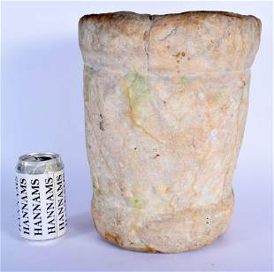 A VERY EARLY BRITISH CARVED MARBLE MORTAR decorated in