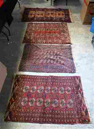 FOUR VINTAGE RUGS in various forms and sizes. (4)