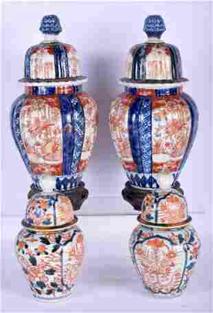 TWO PAIRS OF 19TH CENTURY IMARI VASES AND COVERS.