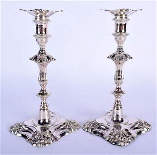 A PAIR OF GEORGE III STYLE SILVER CANDLESTICKS. London