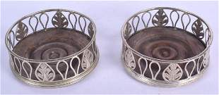 A PAIR OF ANTIQUE CONTINENTAL SILVER COASTERS. 12 cm