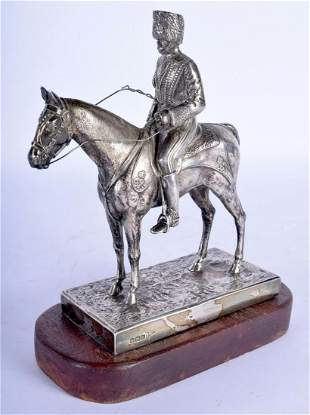 A RARE GEORGE V SILVER FIGURE OF A SOLDIER ON HORSEBACK