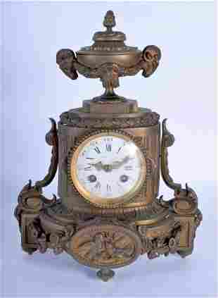 A 19TH CENTURY FRENCH BRONZE MANTEL CLOCK decorated