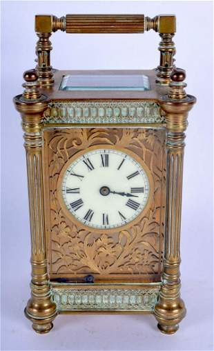 AN ANTIQUE FRENCH CARRIAGE CLOCK with openwork foliate