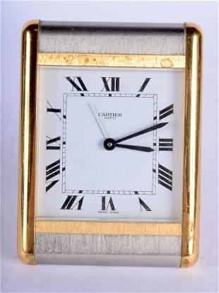 A CARTIER OF PARIS TWO TONE STRUT DESK CLOCK. 10 cm x