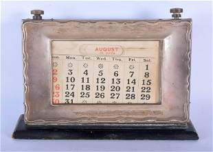 AN ANTIQUE SILVER DESK CALENDAR. 20 cm x 15 cm.