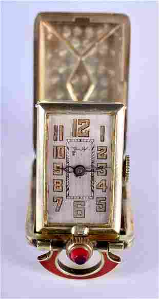 A VINTAGE 14CT GOLD AND ENAMEL TRAVELLING WATCH. 37